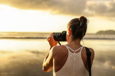A simple profile photo of a photographer in action.