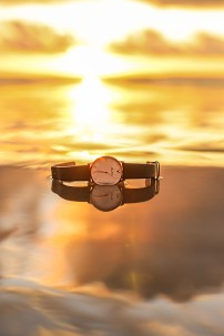 Feeling spontaneous, I took my watch off and gently laid it on the sand far enough away from the water but close enough to get enough light. The watch also serves to document the exact time I captured this shot.